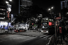 HONG KONG, CHINA - JANUARY, 17:  Hong Kong nightlife. Nightlife starts from 10 PM, offers a variety of bars, shops and restaurants. A lot of tourists, taxis Royalty Free Stock Photo
