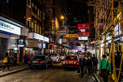 HONG KONG, CHINA - JANUARY, 17:  Hong Kong nightlife. Nightlife starts from 10 PM, offers a variety of bars, shops and restaurants. A lot of tourists, taxis Stock Image