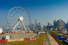 HONG KONG, CHINA - JANUARY 26, 2017: The popular icon Observation Wheel in Hong Kong island, near Ferry Pier arera with landmark b Stock Photography