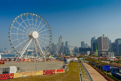 HONG KONG, CHINA - JANUARY 26, 2017: The popular icon Observation Wheel in Hong Kong island, near Ferry Pier arera with landmark b Stock Images