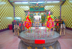 HONG KONG, CHINA - JANUARY 26, 2017: Tsz wan temple, with a hell representation, with an inciense over a table with some Royalty Free Stock Photos