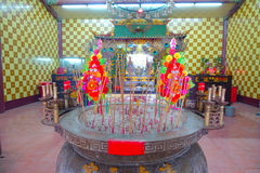 HONG KONG, CHINA - JANUARY 26, 2017: Tsz wan temple, with a hell representation, with an inciense over a table with some Royalty Free Stock Photo
