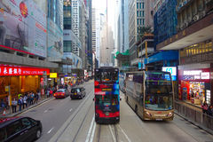 HONG KONG, CHINA - JANUARY 26, 2017: Two double-deck busses in Hong Kong, China. The Double-deck trams system in Hong Kong is one Stock Photos