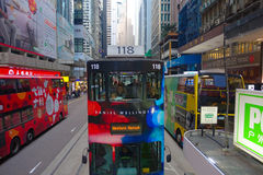 HONG KONG, CHINA - JANUARY 26, 2017: Two double-deck busses in Hong Kong, China. The Double-deck trams system in Hong Kong is one Stock Image