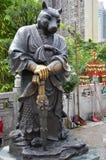 Hong Kong, China - June 25, 2014: Chinese Zodiac Bronze Dog Stat. Ure at Sik Sik Yuen Wong Tai Sin Temple stock photos
