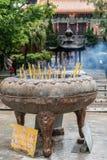Incense burning receptacle, Hong Kong China. Hong Kong, China - March 7, 2019: Lantau Island. Po Lin Buddhist Monastery. Large brown stone, metal receptacle stock photography