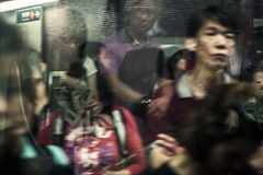 Hong Kong, China - 20 May, 2009: Commuters in a crowded metro  Royalty Free Stock Photo