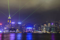 HONG KONG, CHINA - OCTOBER 2013: A Symphony of Lights show on the skyline. HONG KONG, CHINA - OCTOBER 2013: The famous A Symphony of Lights show on the skyline Royalty Free Stock Photos