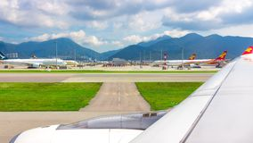 Hong Kong, China - September 22, 2018: Landscape with airplanes in Hong Kong International Airport. View from the aircraft royalty free stock image