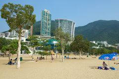 People relax at the Stanley town beach in Hong Kong, China. Royalty Free Stock Image