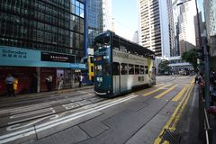 Hong Kong / China 06 26 2018: A streetcar crosses Pedder Street on Des Voeux Road Central Royalty Free Stock Image