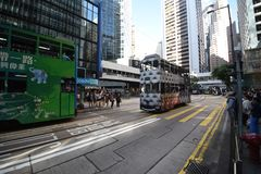 Hong Kong / China 06 26 2018: A streetcar crosses Pedder Street on Des Voeux Road Central Stock Photo