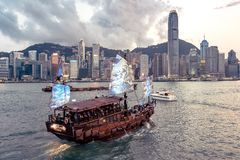 Hong Kong, China - Tourist boat crossing the harbour from Kowloon to Hong Kong island royalty free stock photography
