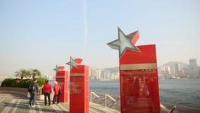 Hong Kong Chiny, Styczeń, - 1, 2016: Historia Hong Kong kino na czerwonych stojakach aleja gwiazdy turyści Obrazy Royalty Free