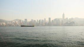 Hong Kong Chiny, Styczeń, - 1, 2016: Widok miasto Hong Kong i morze z spławowym statkiem Panorama miasto Fotografia Stock