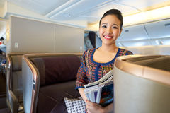 Singapore Airlines. HONG KONG - CIRCA SEPTEMBER, 2016: Singapore Airlines crew member on board of Boeing 777. Singapore Airlines Limited is the flag carrier of Royalty Free Stock Photography