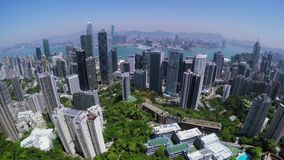 Hong Kong City Aerial. Beautiful Clear Blue Sky. 4K Aerial view capturing the general Hong Kong Island. Wide aerial forward shot flying over office buildings stock video