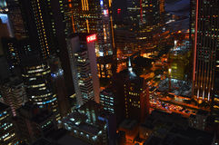 Hong Kong city lighting in nigt colorful wiev from rooftop. Hong Kong city lighting in night. Birdseye wiev from rooftop bar on 35th floor Royalty Free Stock Photo