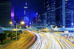 Hong Kong city at night with light trails stock images