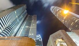 Hong Kong City Scape And-Mist in Hemel Stock Afbeeldingen