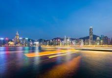 Hong Kong city at dusk. Hong Kong city skyline at dusk with lights of boat in Victoria harbor Royalty Free Stock Photos
