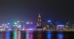 Hong Kong city skyline. HONG KONG - June 14: Hong Kong city skyline at night over Victoria Harbor June 14 2014. Victoria Harbour is a natural landform harbour Stock Images