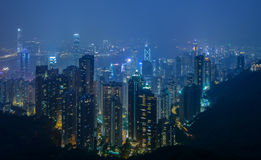 Hong Kong city skyline at night. HONG KONG - June 15: Hong Kong city skyline at night over Victoria Paek June 15 2014. Victoria peak is a mountain in the western Stock Images