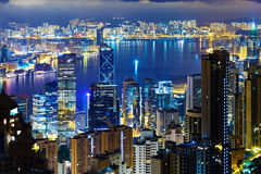 Hong Kong city skyline at night with Victoria Harbor and skyscra Royalty Free Stock Images
