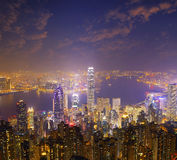 Hong Kong city skyline panorama at night with Victoria Harbor Royalty Free Stock Photography