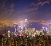 Hong Kong city skyline panorama at night with Victoria Harbor Royalty Free Stock Photography