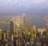 Hong Kong city skyline panorama at night with Victoria Harbor Royalty Free Stock Photos