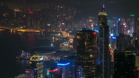 Hong Kong city skyline timelapse at night with Victoria Harbor and skyscrapers illuminated by lights over water viewed stock footage