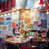 Hong Kong city street restaurant with asian food Stock Images