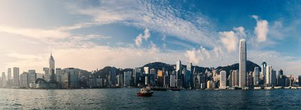 Hong Kong cityscape over Victoria Harbour. Panorama view of Hong Kong cityscape over Victoria Harbour in the morning Royalty Free Stock Photo