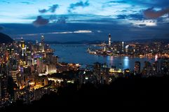 Hong Kong Cityscape and Victoria Harbour by Night. BRAEMAR HILL, HONG KONG - MAY 30, 2013 - Hong Kong Cityscape and Victoria Harbour by Night stock photo