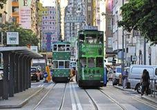 Hong Kong cityscapesikt med berömda spårvagnar Royaltyfria Bilder
