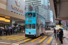 Hong Kong cityscapesikt med dendäck elkraftspårvagnen Arkivfoto