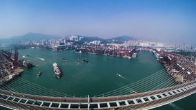 Hong Kong Container Port. Hong Kong 4K Aerial Top View. 4K aerial shot of the Kwai Chung terminal. Flying over the bridge. Container vessels on sea and crane stock footage