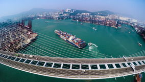 Hong Kong Container Port. Hong Kong 4K Aerial Top View. 4K aerial upward shot of the Kwai Chung terminal with traffic on bridge. Container vessels on sea and stock footage