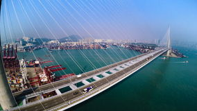 Hong Kong Container Port. Hong Kong 4K Aerial Top View. 4K aerial upward shot of the Kwai Chung terminal with traffic on bridge. Container vessels on sea and stock video