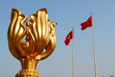 Hong Kong Convention Center. Statue and flags at Hong Kong Convention Center Stock Photos