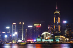 Hong Kong city skyline at night. Night view of Hong Kong Convention and Exhibition Center at Victoria Harbour, with illuminating high rise buildings in the Stock Photography