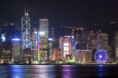 Hong Kong city skyline at night. Night view of Hong Kong at Victoria Harbour waterfront, with illuminating high rise skyscrapers from Central district, including Royalty Free Stock Photos