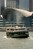 Hong Kong Convention And Exhibition Centre. A ferry passing by Hong Kong Convention And Exhibition Centre Stock Photography