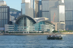 Hong Kong Convention and Exhibition Centre. And ferry in habor Stock Photo