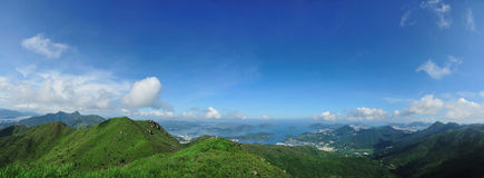 Hong Kong country side. With hill, green plants, blue sky and sea stock photography