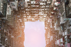 Hong Kong crowded apartment against sky bottom view Stock Image