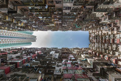 Hong Kong crowded residence apartment building bottom view. Cityscape background Stock Images