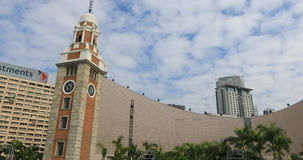 Hong Kong Cultural Centre. Hong Kong, China - December 5, 2016: panorama view of iconic landmarks in Tsim Sha Tsui, Victoria Harbour waterfront: Clock Tower and stock footage