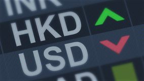Hong Kong currency rising, American dollar falling, exchange rate fluctuations. Stock photo stock photography